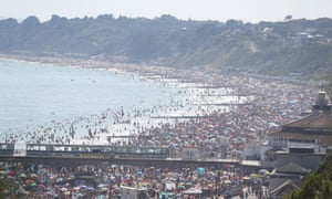 Thousands pack the beach in Bournemouth on Wednesday.