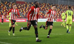 Brentford's Josh Dasilva (centre) celebrates after opening the scoring.