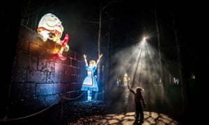 a girl looks at illuminated light sculptures during the Alice in Winterland show at Lightwater Valley, North Yorkshire.