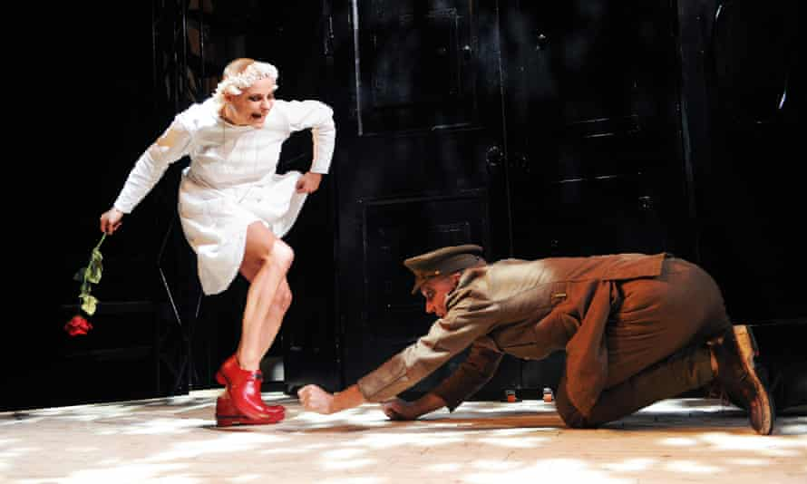 Patrycja Kujawska as The Girl and Robert Luckay as The Soldier in Kneehigh't production of The Red Shoes.