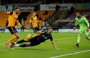 Harry Kane of Tottenham Hotspur goes down in the area with Romain Saiss of Wolverhampton Wanderers.