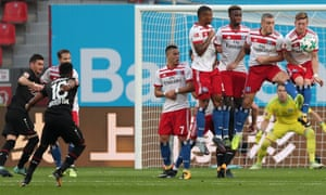 Leverkusen's Wendell fires a free-kick past the Hamburg wall.