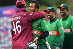 West Indies' Darren Bravo hugs Shakib Al Hasan as he walks off the pitch.