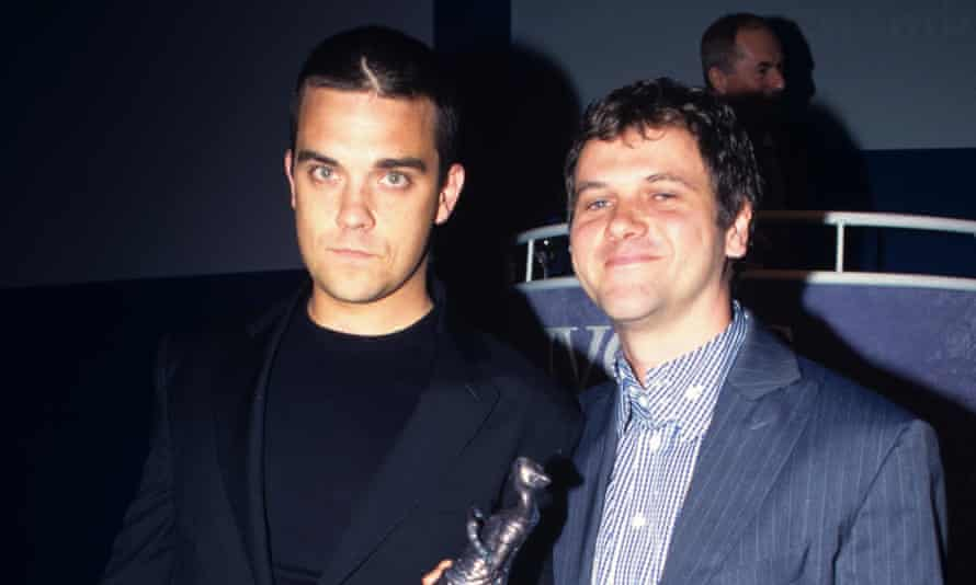 Long-term songwriting partnerships such as that of [L-R] Robbie Williams and Guy Chambers could offer one solution to the trials facing songwriters.