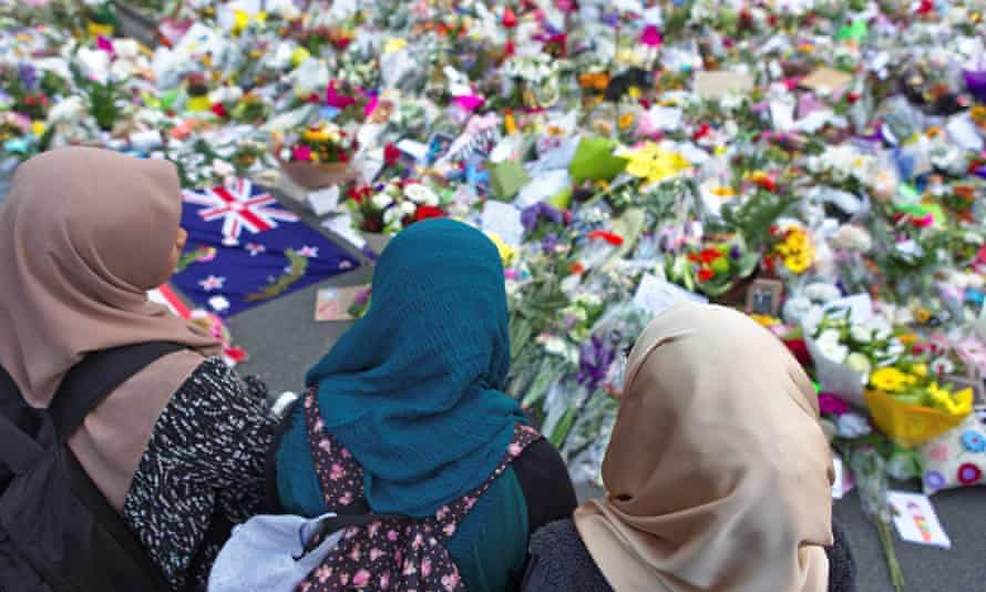 A group of women pay tribute to the victims of the mosque attacks at botanic garden memorial, in Christchurch, New Zealand, in March 2019.