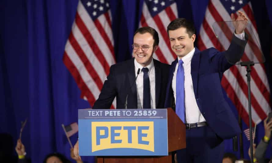 Democratic presidential candidate Pete Buttigieg on stage with his husband Chasten Buttigieg at a primary night election rally in Nashua, New Hampshire, on 11 February.