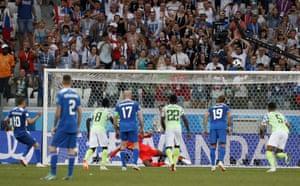 Sigurdsson kicks the penalty over the bar.
