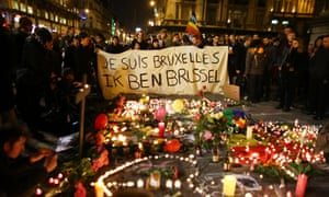 People hold up a banner as a mark of solidarity at the Place de la Bourse following attacks on 22 March in Brussels, Belgium