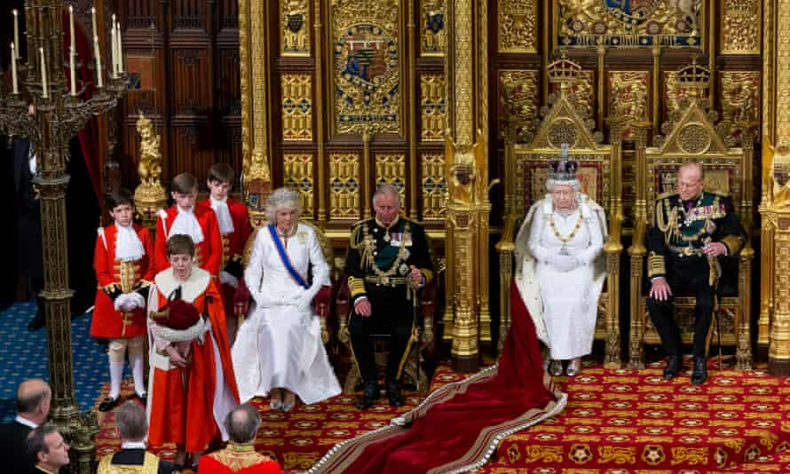 Queen Elizabeth is accompanied by Prince Philip, right, Prince Charles and the Duchess of Cornwall, at the state opening of parliament.