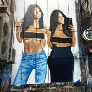 Mural of Kim Kardashian posing topless with model Emily Ratajkowski, painted by Melbourne street artist Lushsux on Sniders Lane in Melbourne, Australia.