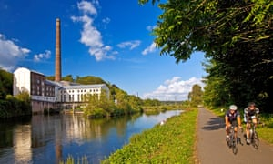 Horster Muehle hydroelectric power plant at Ruhr river and Ruhr Valley Cycleway with two cyclists
