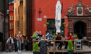 People sit in a restaurant in Stockholm on 29 May