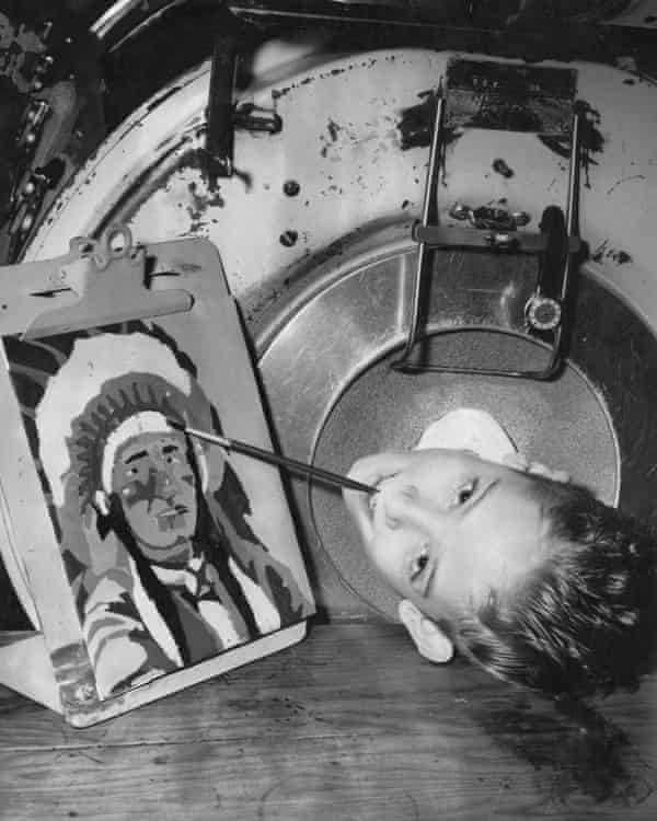 Paul Alexander, who was paralysed by polio in 1952, painting with his mouth inside an iron lung, circa 1960s