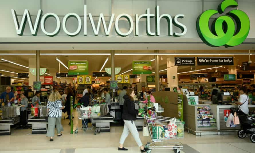 front of a busy woolworths supermarket