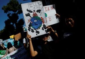 Students hold placards in Kathmandu, Nepal