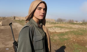 A female Kurdistan Workers' Party (PKK) fighter at a security position in Sinjar, 13 March, 2015.