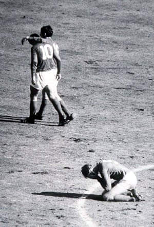 Jack Charlton falls to his knees in relief as team-mate Geoff Hurst, number ten, walks away with Martin Peters after completing his hat-trick in the final seconds