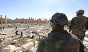 Soldiers, in 2016, look over damage at the Temple of Bel in the historical city of Palmyra in Homs, Syria