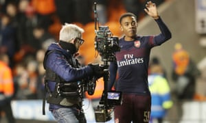 Joe Willock waves to the celebrating Arsenal fans after the final whistle.