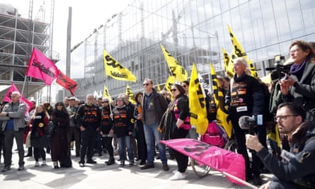 French trade unions demonstrate outside a Paris courthouse as the trial of the executives begins.