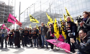 French union members demonstrate at the start of the trial in Paris in May 2019