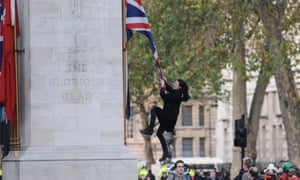 Charlie Gilmour climbing the Cenotaph, a memorial to those who died in the first world war.