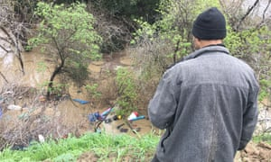Phillip Quiroz looks at the encampment flooded by Coyote Creek.