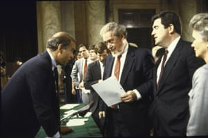 Senate Judiciary Committee Chairman Joseph R. Biden Jr., chatting with Supreme Court Nominee Robert H. Bork and others; after first day of hearings to confirm Bork.