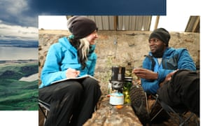 Phoebe Smith and Dwayne Fields cook on a camping stove