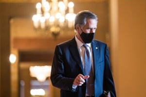 Republican Senator from Utah Mitt Romney walks to the Senate floor. He voted to impeach Donald Trump twice.