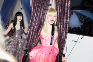 Model Lily McMenamy wearing one of Bovan's bum cushion dresses, celebrates backstage.