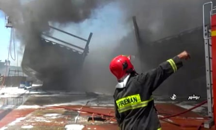 Firefighters tackle the fire at the Delvar Kashti Bushehr boat factory in the Iranian city of Bushehr.