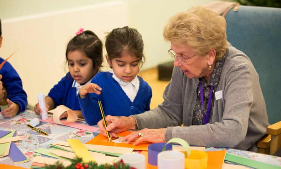 London primary school hosting elderly day care centre three mornings a week for local people with signs of early dementia. It is meant to be mutually beneficial for the children and elderly adults.