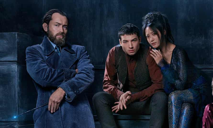 Jude Law as Albus Dumbledore, Ezra Miller as Credence and Claudia Kim in Fantastic Beasts: Crimes of Grindelwald