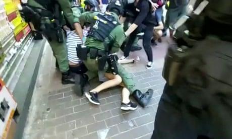 Hong Kong police violently arrest 12-year-old girl –video