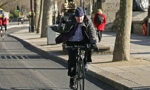 London's mayor, Boris Johnson, rides down a new section of bike lane on Embankment.