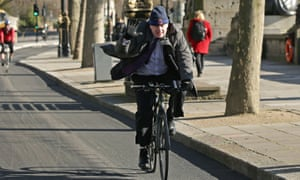 A former mayor of London pedals along the Embankment.