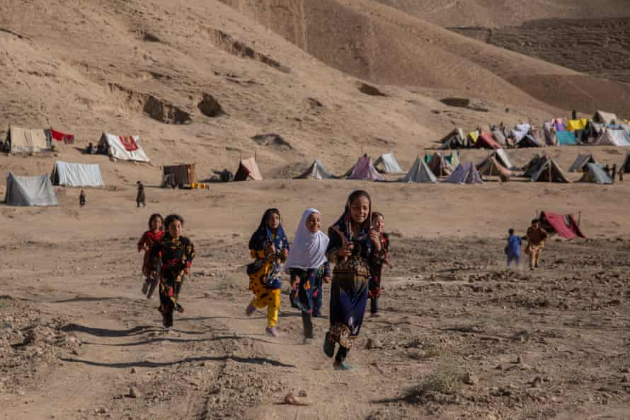 Children in Qala-i-Naw's new IDP camp, where hundreds of families have gathered in need for water