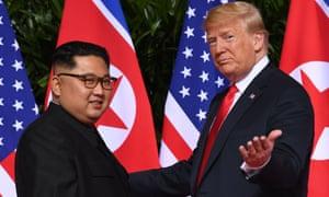 Donald Trump gestures as he meets Kim Jong-un in Singapore in June.