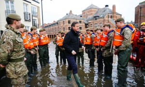 David Cameron and flood relief workers