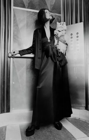From Vogue 1972. Model in an elevator in New York's Chrysler building, holding a white cat