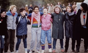 Protesters link arms at Greenham Common in 1983.