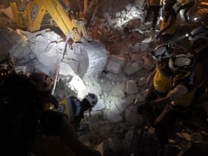 Rescue workers sift through debris in the aftermath of airstrikes by the Assad regime over the de-escalation zone of Saraqib district in Idlib, June 2019.