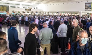 Tourists wait to board flights at the Cesar Manrique-Lanzarote Airport in Arrecife, Canary Islands, the current holiday location of up to 90,000 overseas visitors.