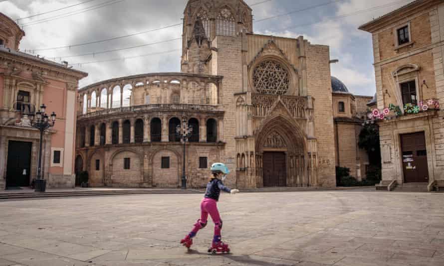 A child skates in a deserted square in Valencia, Spain.