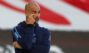 Manchester City manager Pep Guardiola looks on with frsutration.