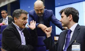 Greek finance minister Euclid Tsakalotos (left) talks with EU commissioner Pierre Moscovici (centre) and Greece's deputy finance minister George Chouliarakis.