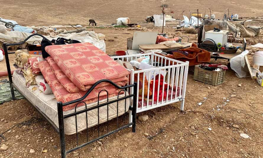 The belongings of 73 people who were forcibly displaced by Israeli forces stand in the Jordan Valley in the occupied West Bank.