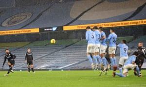 Aston Villa's Douglas Luiz shoots at goal from a free kick.