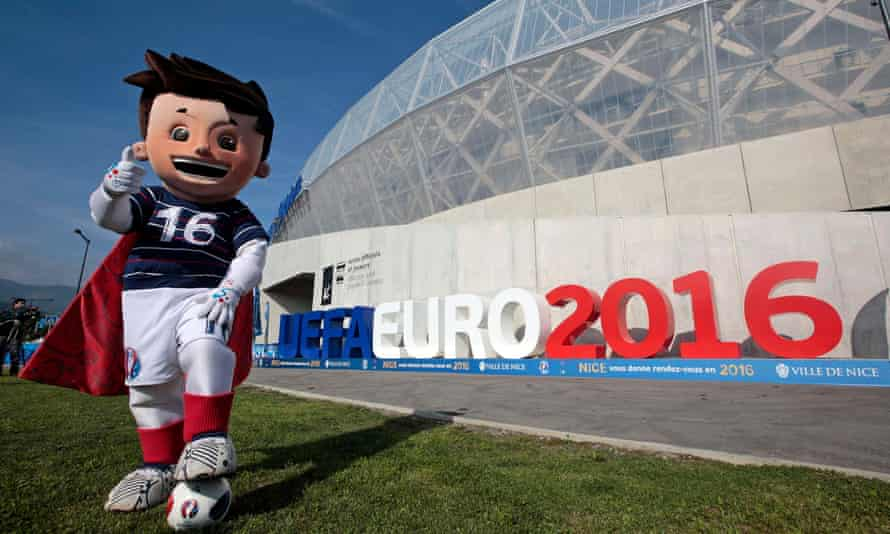 The official Mascot, Super Victor, poses in front of the UEFA Euro 2016 logo at the Allianz Riviera stadium in Nice, France.